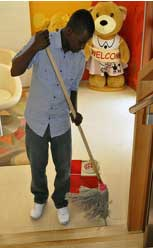 Man cleaning up to prevent ants from coming in the house