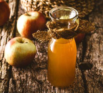 Photo of a homemade apple cider vinegar solution for indoor flea control